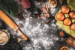 Christmas cooking baking background. Christmas, New Year holiday cooking background. Ingredients, spices, dried oranges and baking molds, Christmas decorations Royalty Free Stock Photography