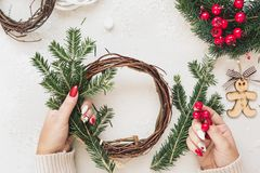 Woman Making A Christmas Grapevine Wreath royalty free stock photos