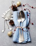 Christmas and New Year holiday table place setting decorations. Grey background. Top view. Christmas and New Year holiday table place setting decorations. Grey stock photography