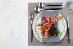 Christmas And New Year Holiday Table Setting. Celebration Place setting for Dinner Decorations Copy space Top view Stock Photos