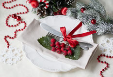 Christmas And New Year Holiday Table Setting. Celebration. Place setting for Christmas Dinner. Holiday Decorations. Decor. Stock Photo