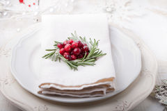 Christmas And New Year Holiday Table Setting with cranberry  decoration. Stock Image