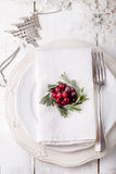 Christmas And New Year Holiday Table Setting with cranberry  decoration. Royalty Free Stock Images
