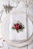 Christmas And New Year Holiday Table Setting with cranberry  decoration. Royalty Free Stock Photo