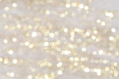 Christmas and new year holidays blurred golden and shiny bokeh background royalty free stock photography