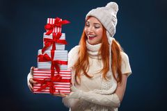 Christmas and New Year holidays. Happy woman holding gift boxes on dark background in black friday. Sales on christmas Stock Photo
