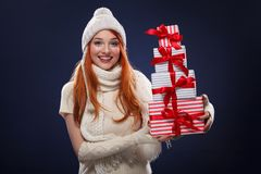 Christmas and New Year holidays. Happy woman holding gift boxes on winter background in black friday. Sales on christmas Stock Photo