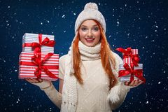 Christmas and New Year holidays. Happy woman holding gift boxes on winter background in black friday. Sales on christmas Stock Photos