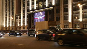 Christmas (New Year) holidays illumination and Building of The State Duma at night, Moscow, Russia stock video