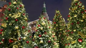 Christmas and New Year holidays illumination and Manege Square at night. Moscow, Russia.  stock video