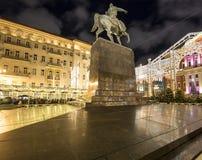 Christmas and New Year holidays illumination in Moscow city center on Tverskaya square at night. Yury Dolgoruky  Monument Stock Image