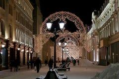Christmas (New Year holidays) illumination on Nikolskaya Street near the Moscow Kremlin at night, Russia Royalty Free Stock Photo