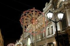 Christmas (New Year holidays) illumination on Nikolskaya Street near the Moscow Kremlin at night, Russia Royalty Free Stock Images