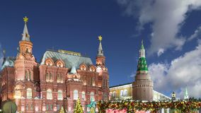 Christmas New Year holidays illumination and State Historical Museum inscription in Russian at night, near the Kremlin in Mos. Cow, Russia stock video