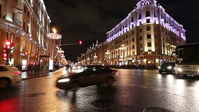 Christmas and New Year holidays illumination and Traffic of cars  in Moscow city center and Government building. On Tverskaya street at night, Russia stock video footage