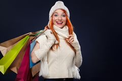 Christmas and New Year holidays.. Shopping woman holding color bags and on winter background with snow in black friday Royalty Free Stock Photo