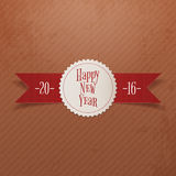 Christmas or New Year Label and red Ribbon. Realistic white Christmas or New Year Label Template and red Ribbon on Cardboard Background. Vector Illustration Royalty Free Stock Image