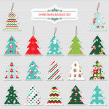 Christmas and new year labels and stickers. Christmas and new year labels and stickers in the shape of a christmas tree. Different festive patterns are full Royalty Free Stock Photo