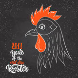 Christmas and New Year lettering calligraphy greeting card with 2017 year of the red fire rooster on the black Royalty Free Stock Photo