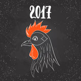 Christmas and New Year lettering calligraphy greeting card with 2017 year of the red fire rooster on the black Royalty Free Stock Image
