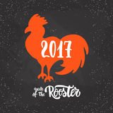 Christmas and New Year lettering calligraphy greeting card with 2017 year of the red fire rooster on the black. Christmas and New Year lettering calligraphy stock illustration