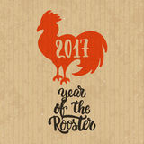 Christmas and New Year lettering calligraphy greeting card with 2017 year of the red fire rooster on the cardboard box. Christmas and New Year lettering stock illustration