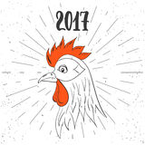 Christmas and New Year lettering calligraphy greeting card with 2017 year of the red fire rooster. Cock drawing on the Royalty Free Stock Photo