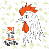 Christmas and New Year lettering calligraphy greeting card with 2017 year of the red fire rooster. Cock drawing and. Christmas and New Year lettering calligraphy Royalty Free Stock Image