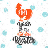 Christmas and New Year lettering calligraphy greeting card with 2017 year of the red fire rooster. Cock silhouette on Royalty Free Stock Photography
