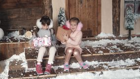 Christmas or New Year. children exchange gifts for Christmas. two little girls on the background of the New Year`s. Christmas or New Year. a little girl hanging stock video footage