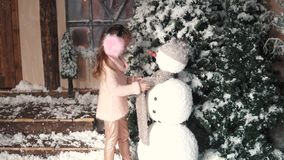 Christmas or new year. a little girl makes a snowman stock footage