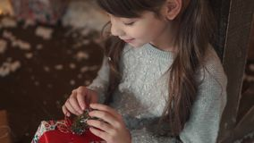 Christmas or new year. a little girl sees a box of gifts stock video