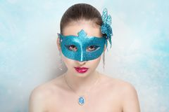 Woman blue mask Stock Images