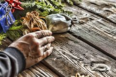 Man puts presents under the Christmas tree. Stock Photography