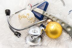 Christmas and New Year in medicine idea. Stethoscope internal medicine and neurological hammer neurology and neuroscience are. Surrounded by decorations - white royalty free stock image