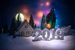 Christmas and New Year miniature house in the snow at night with fir tree. Little toy house on snow with tree. Festive background. Christmas decorations stock image