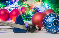 Christmas and New Year in neurology, medicine or neuroscience photo - two neurological hammer are located near balls for Christmas. Tree in blurry background stock photos