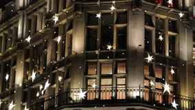 Christmas and New Year night decoration on the facade of an building in neo-gothic style,stars and shimmering lights.  stock video footage