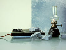Christmas, new year. oil lamp with books. space for text Royalty Free Stock Image