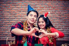 Christmas and New year party. With friends. Couple Heart-shaped hand Stock Photography