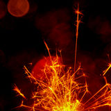 Christmas and New Year party sparkler with abstract circular bokeh background Royalty Free Stock Photography