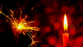Christmas and New Year party sparkler and Candle flame light Royalty Free Stock Images