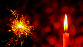 Christmas and New Year party sparkler and Candle flame light Stock Images