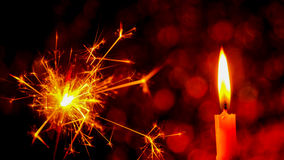 Christmas and New Year party sparkler and Candle flame light. At night with abstract circular bokeh background Christmas lights Stock Images