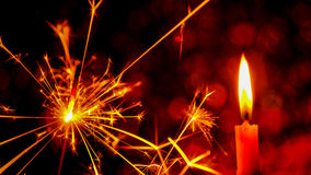Christmas and New Year party sparkler and Candle flame light. At night with abstract circular bokeh background Christmas lights Royalty Free Stock Photography