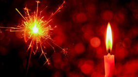 Christmas and New Year party sparkler and Candle flame light. Christmas and New Year party sparkler and Candle flame light at night with abstract circular bokeh Stock Photo