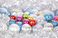 Christmas and New Year pattern, ornament of bright multi-colored glass decorative balls and tinsel, lights and sparkles, closeup. Copy space stock photos