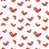 Christmas and New Year pattern with red socks. Vector seamless pattern Stock Image