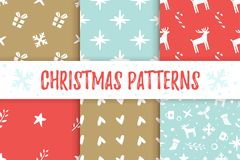 Christmas New Year pattern. Vector set of Christmas and New Year red and blue seamless patterns with holiday symbols Royalty Free Stock Photos