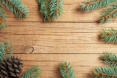 Christmas new year pine tree and cones decoration background. xmas and christmas on wooden table backdrop copy spaces royalty free stock image